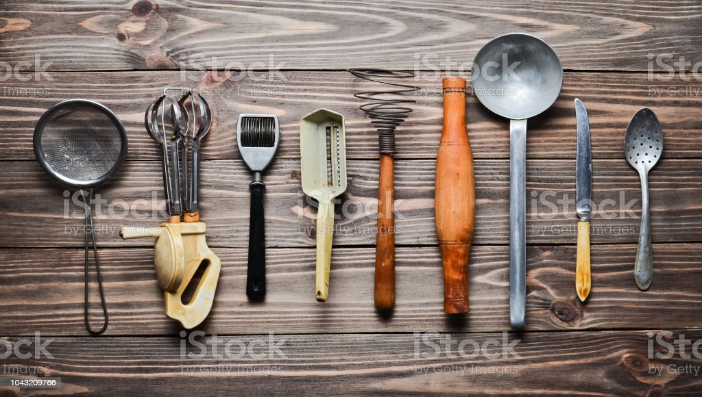 A Set Of Old Kitchen Tools And Cutlery On A Wooden Table ...