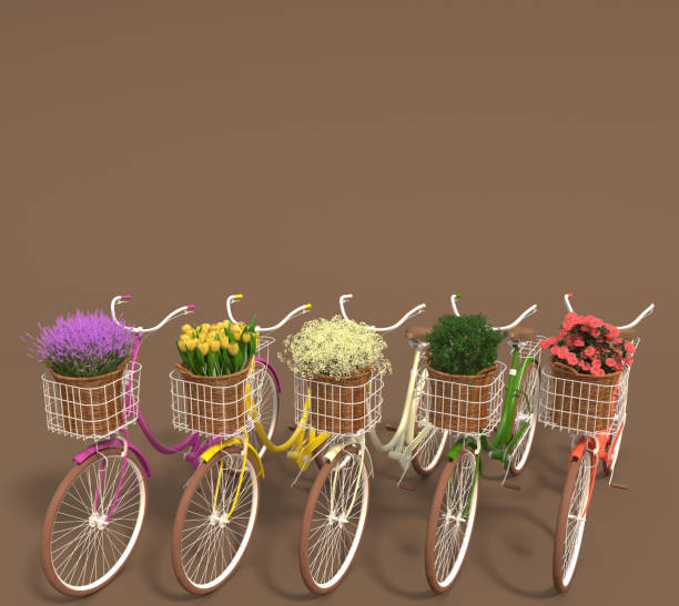 Set of old retro bicycles with multicolored flowers in baskets stand in a row on a brown background. Copy space. stock photo