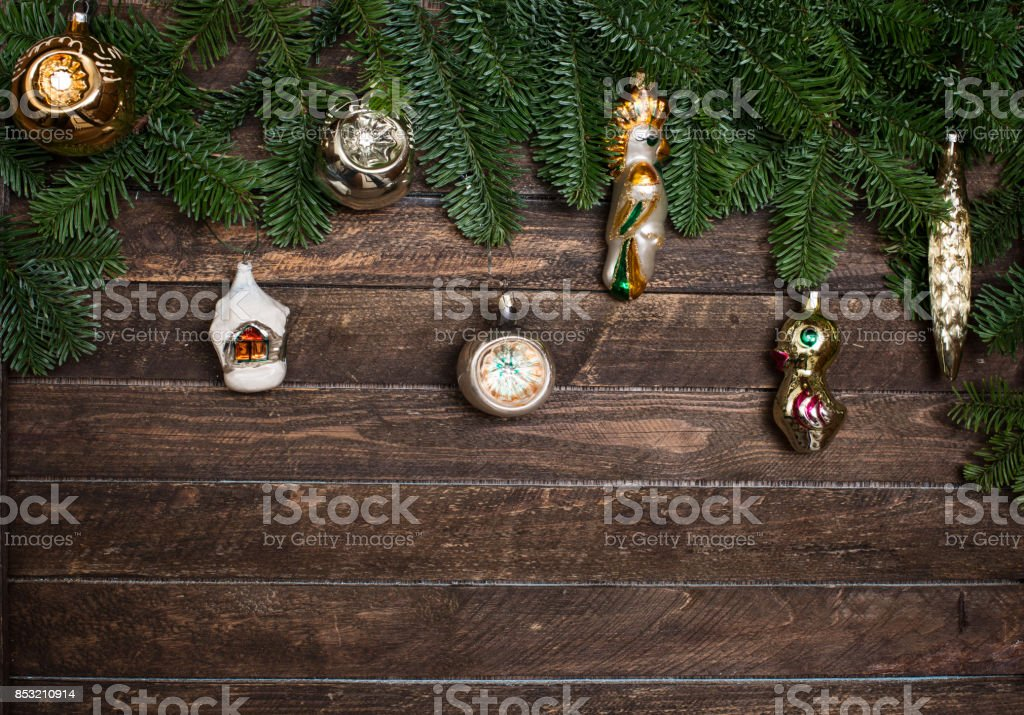 Set of old retro toys for decorating with Christmas tree branch on wooden rustic background. New Year background stock photo