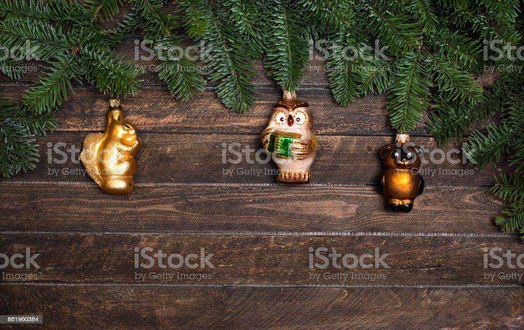 Set of old retro toys for decorating with Christmas tree branch on wooden rustic background. New Year background. stock photo