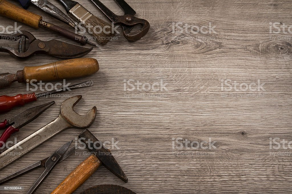 Set of Old Work Tools on Rustic Background stock photo