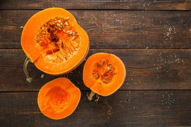 set of orange pumpkins on wood flat lay free space - pumpkin stock photos and pictures