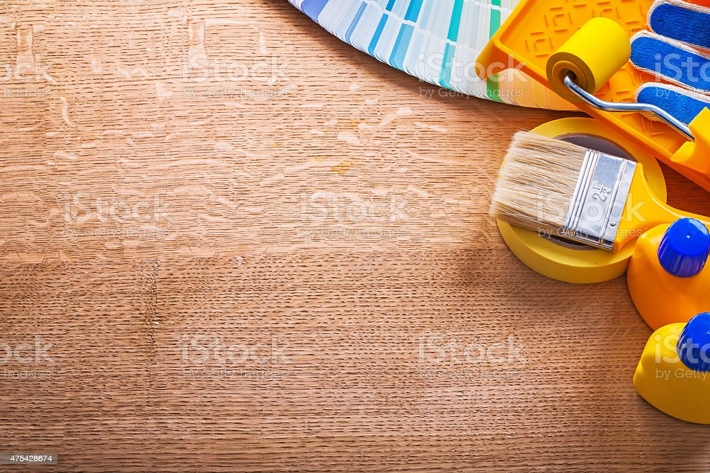 Set of paint tools and pantone color palette guide on stock photo