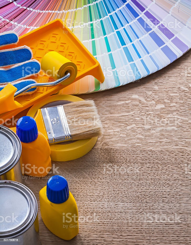 Set of painting tools on wood board construction concept stock photo