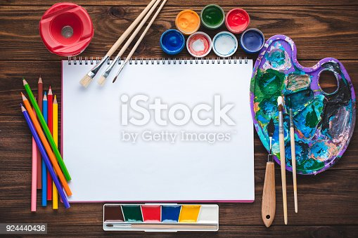 istock Set of paints, pencils, tools for painting and blank white paper sheet 924440436