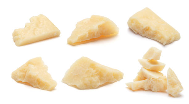set of parmesan cheese pieces on white - parmesan stock photos and pictures