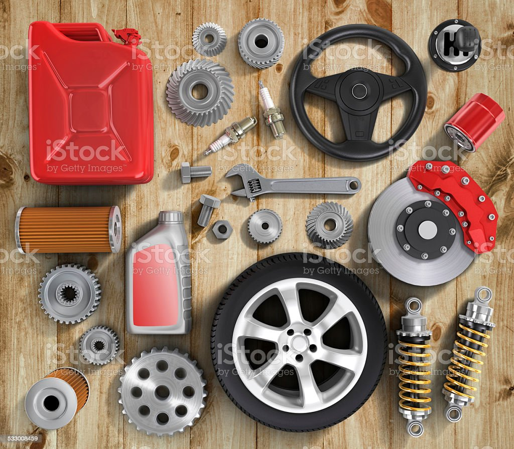 Set of parts of car on wood background. stock photo