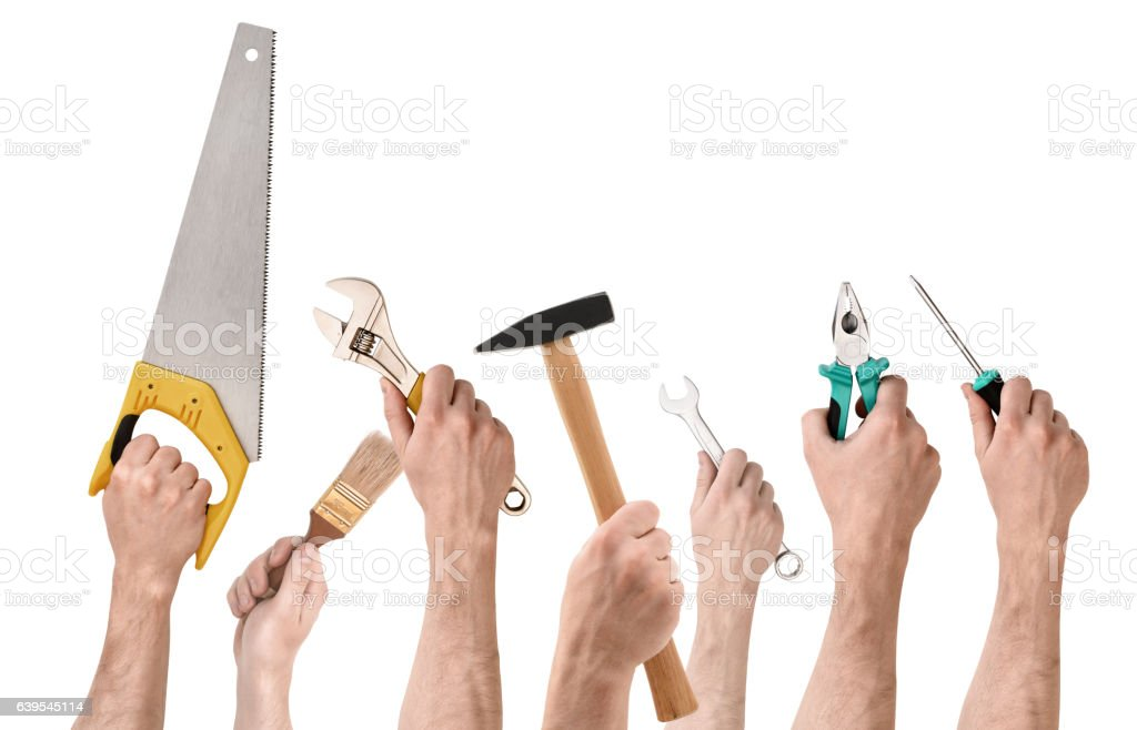 Set of people's hands holding different building tools isolated stock photo
