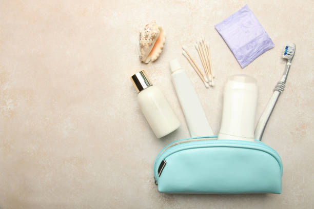 Set of personal care products in blue cosmetic bag for travel stock photo