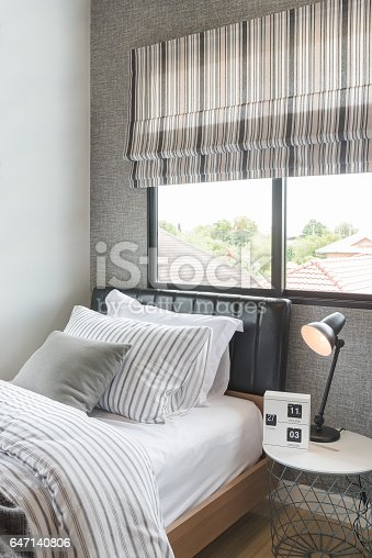 istock set of pillows with blanket on modern wooden bed 647140806