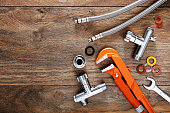 istock Set of plumbing tools on wooden table background. 1153465197