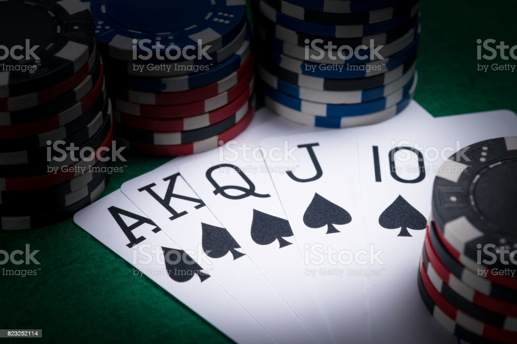 set of poker cards with the best combination for a player in the dark of a casino stock photo