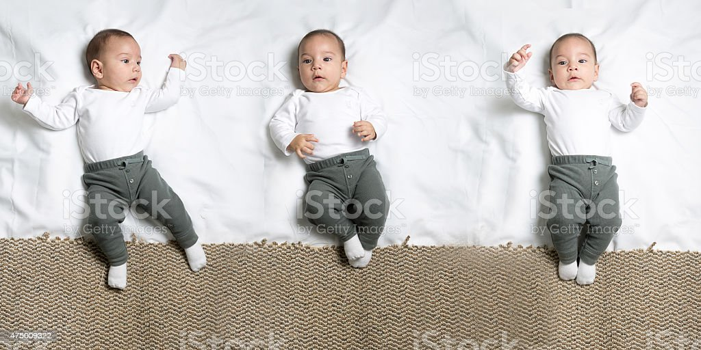 Set of poses Cute baby boy lying on a blanket stock photo