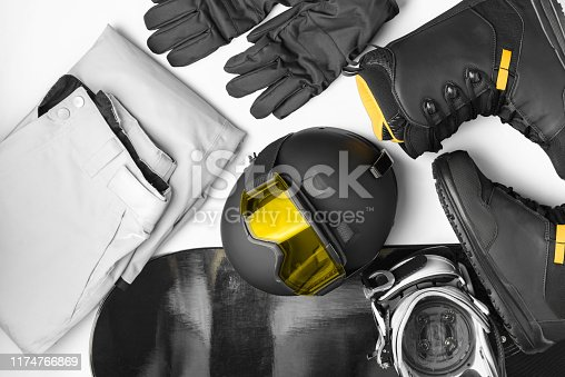 istock Set of protective accessories and clothing for snowboarding, mask glasses,helmet, pants, shoes, gloves, snowboard 1174766869