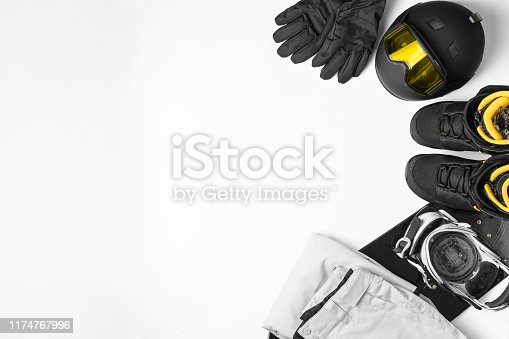 istock Set of protective accessories and clothing for snowboarding, mask glasses,helmet, pants, shoes, gloves, snowboard on white background,top view 1174767996