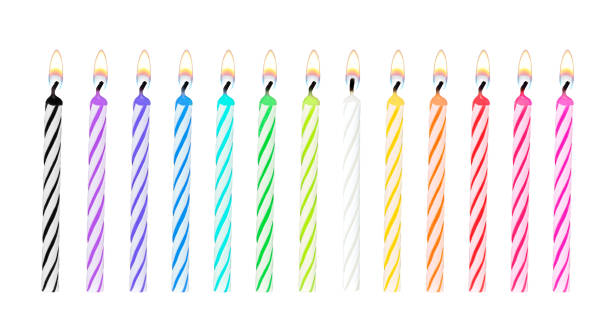 Set of rainbow color birthday or party candles were lit and isolated on white background with clipping path for celebration stock photo