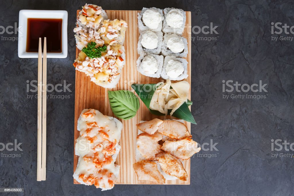 set of real classic Japanese sushi. on a wooden surface stock photo