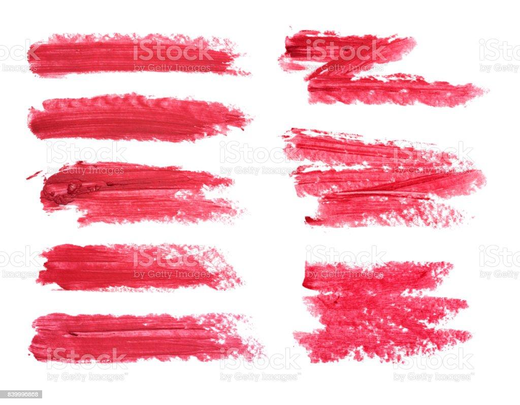 Conjunto de manchas de lápiz labial rojo aislado sobre fondo blanco. Muestra del producto maquillaje manchado. - foto de stock