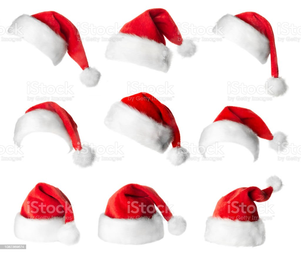 Set of red Santa Claus hats Set of red Santa Claus hats isolated on white background Cap - Hat Stock Photo