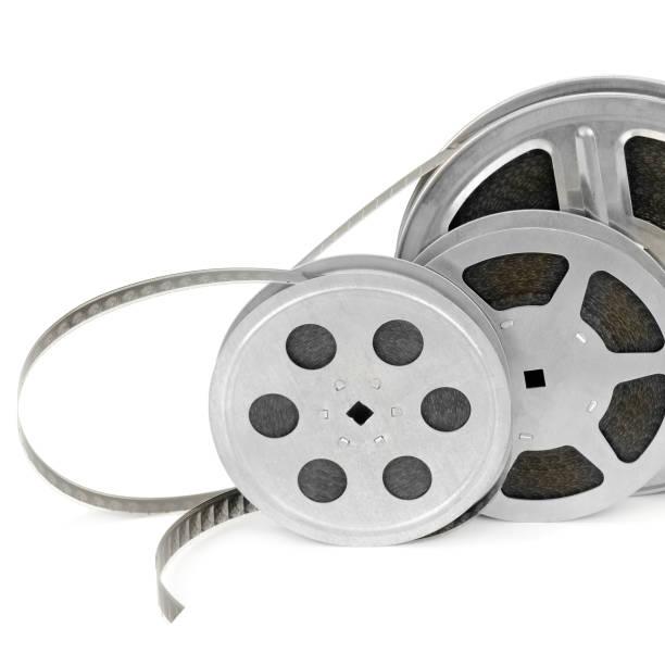 Satz von Rollen mit Filmstreifen auf weißem Hintergrund isoliert. Freier Speicherplatz für Text. – Foto