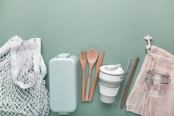 Set of reusable eco friendly products . Zero waste concept. Cotton bags, bamboo cutlery, straw, reusable cup and lunch box stock photo