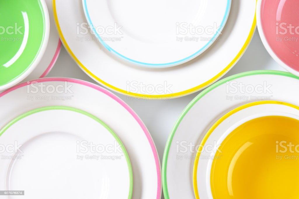 set of rimmed plates and bowls stock photo