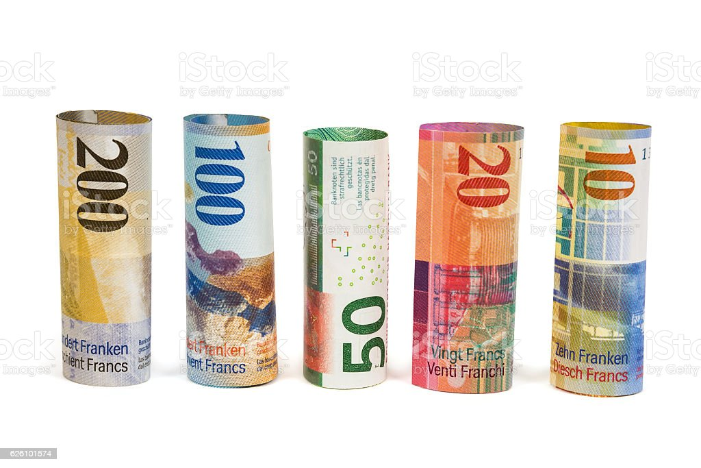 Set of rolled swiss franc banknotes stock photo