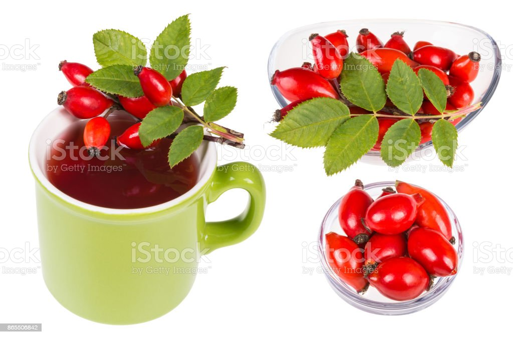 Set of rosehips on mug with hot tea and in glass bowls. Rosa canina stock photo