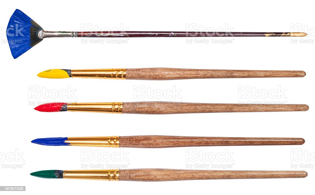 set of round art paintbrushes with painted tips stock photo