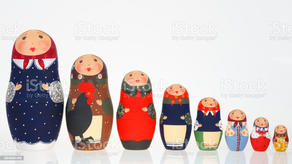 Set of Russian dolls babushka matryoshka lined up isolated on white stock photo
