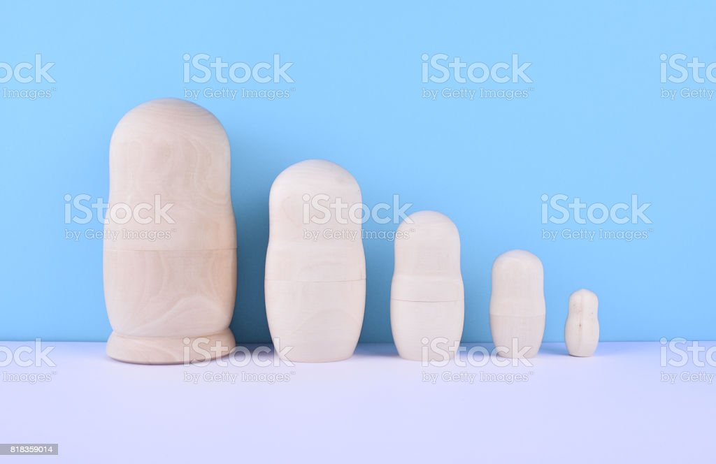 Set of russian dolls on blue background. stock photo