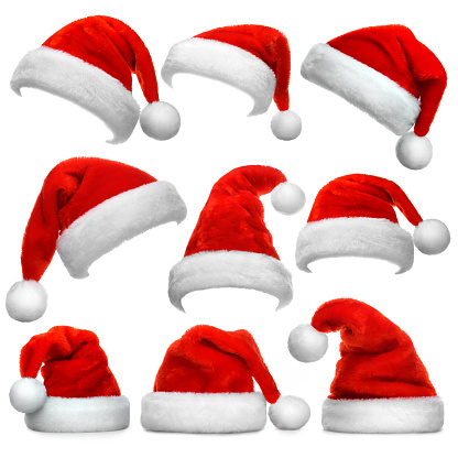 Set of Santa Claus red hats isolated on white background