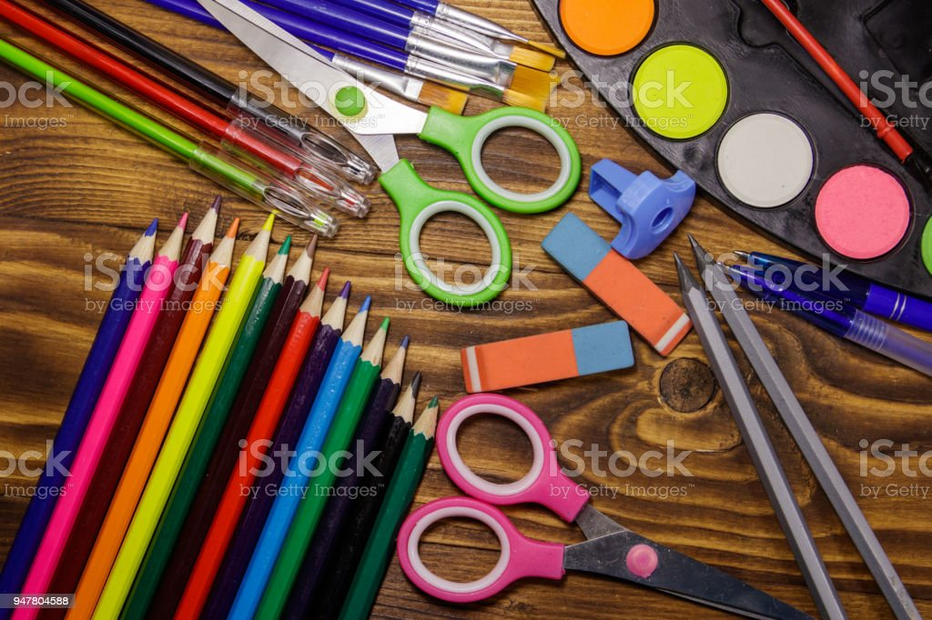 Set of school stationery supplies on wooden desk stock photo
