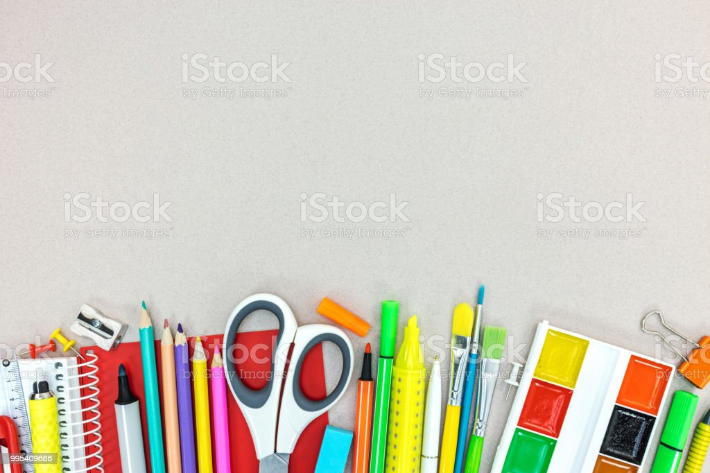 set of school supplies and stationary on grey desk background stock