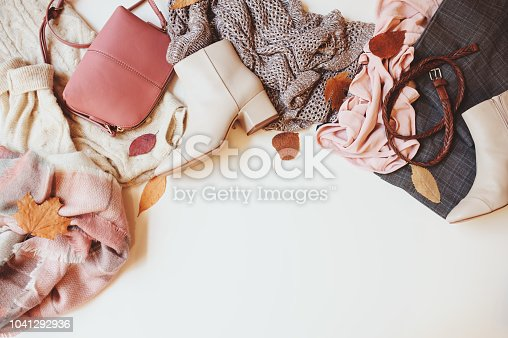 set of seasonal autumn fashion woman clothes, top view with copy space. Trendy shoes, sweater and handbag.