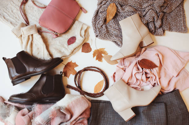 set of seasonal autumn fashion woman clothes, top view with copy space. Trendy shoes, sweater and handbag. stock photo