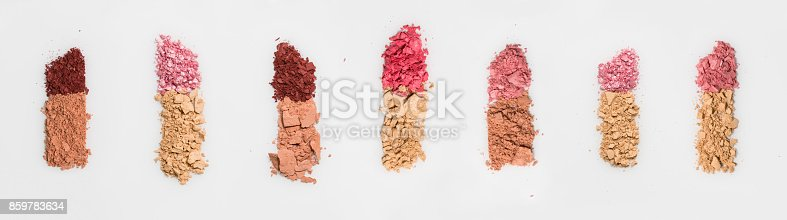 istock Set of seven lipsticks made from crashed face powder and blush, isolated on white background. 859783634