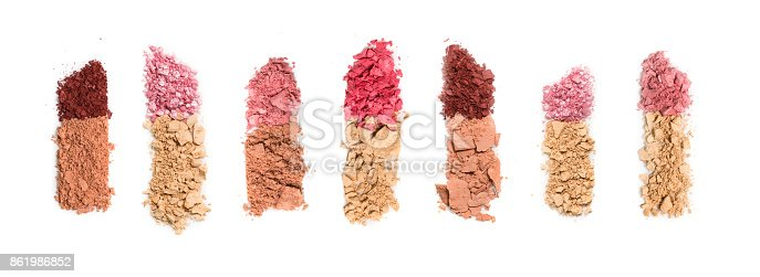 istock Set of seven lipsticks made from crashed face powder and blush, isolated on white background. 861986852