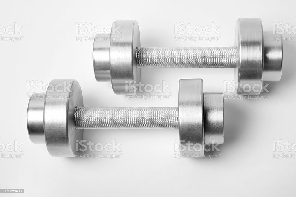 Set of silver Dumbbells against white background royalty-free stock photo
