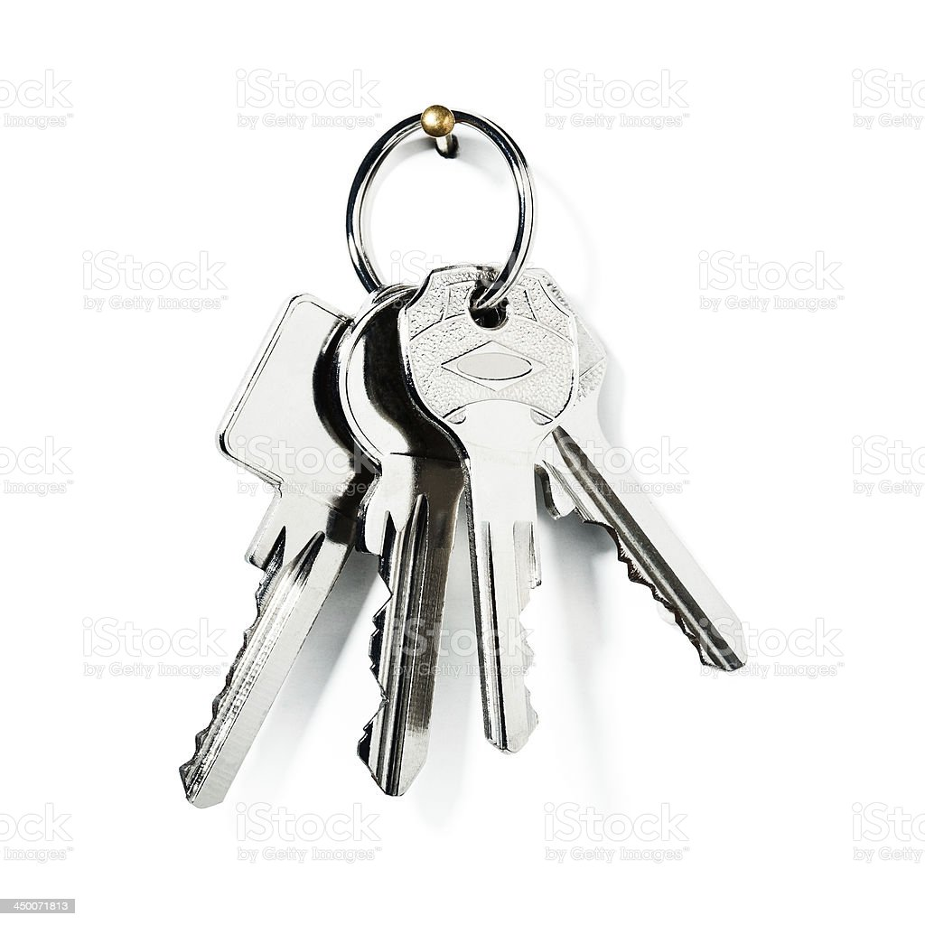 A set of silver keys on a ring hanging from a pin stock photo