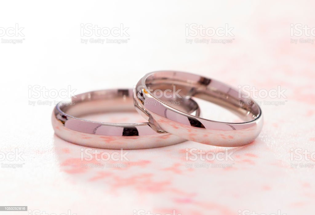 Set Of Simple White Gold Wedding Rings On A Pink Table Stock Photo Download Image Now Istock