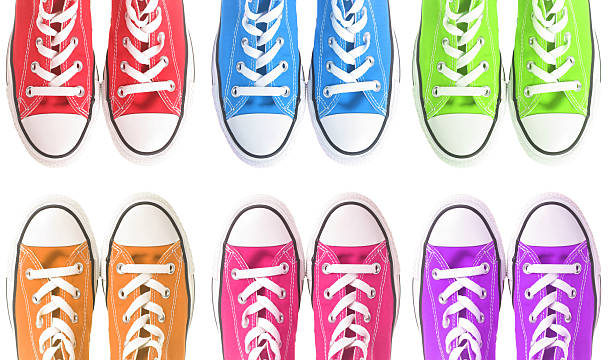 Set of six colorful sneakers over a white background stock photo