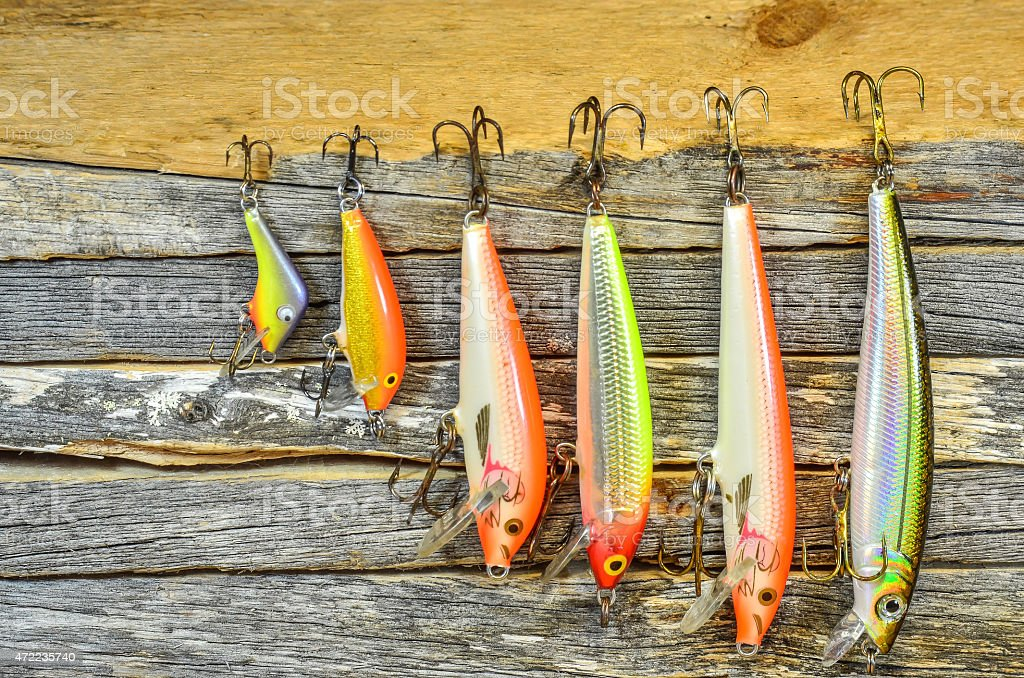 Set of six fishing lures of different sizes stock photo