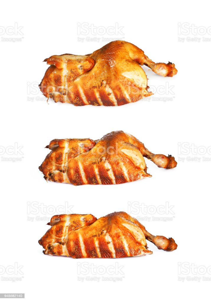 Set of smoked chicken with a ruddy crust isolated on a white background. Festive dish. A collection of half fried chicken. Appetizing meat product of golden color, white meat, barbecue. Top view stock photo