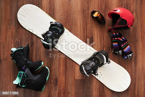 istock set of snowboard boots, helmet, gloves and mask on wooden 956117894