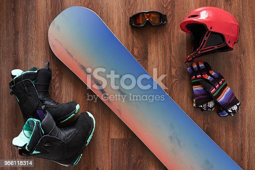 istock set of snowboard boots, helmet, gloves and mask on wooden 956118314