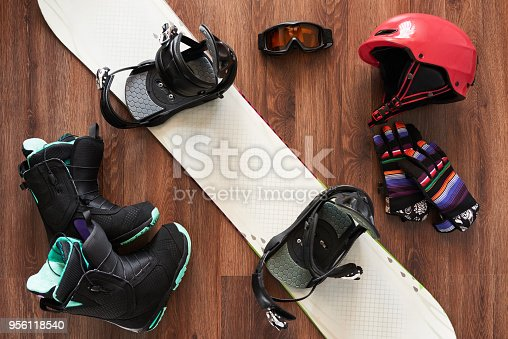 istock set of snowboard boots, helmet, gloves and mask on wooden 956118540