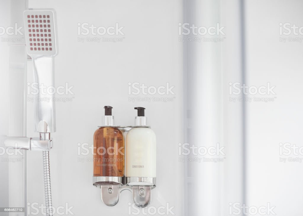Set of soaps in modern shower stock photo
