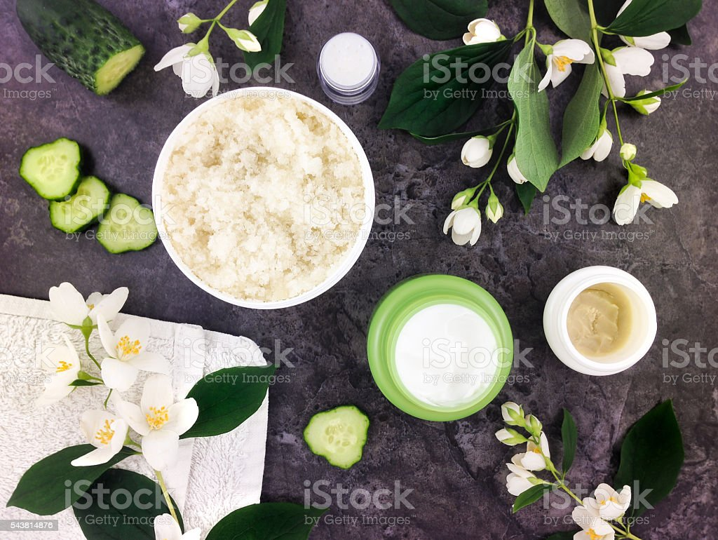 Set of spa treatment products on stone background. Flat lay stock photo