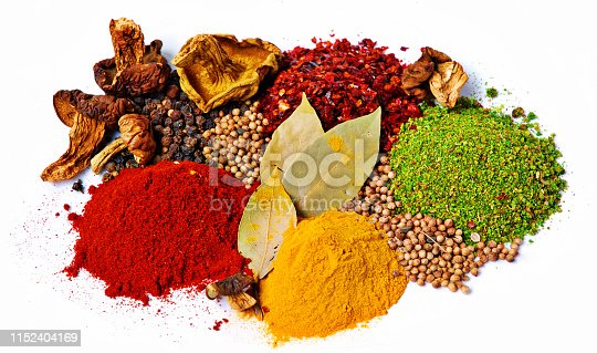 Set of spices, top view isolated on white background.